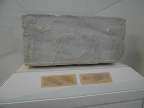 510-500BC Marble base for grave showing young athletes playing a game similar to hockey
