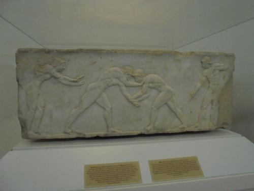 Base of a funerary kouros naked youth, made of Pentelic marble. It was found in Kerameikos, built into the Themistokleian wall. . 510-500 BC