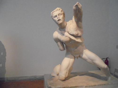 Statue of a fighting Gaul, found in the Agora of the Italians on Delos, the wounded warrior has fallen on his right knee and is attempting to defend himself, about 100 BC